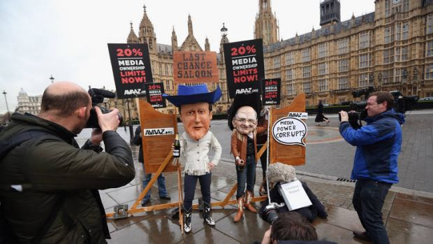 Members of the protest  group 'Avaaz'  campaign outside the Houses of Parliament for the government to implement ...