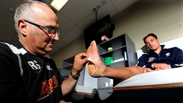 Stopping power: Ray Spiteri gives Blues midfielder David Ellard the treatment … with his Blister Proof patch.