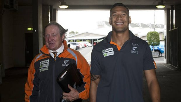 Greater Western Sydney Giants head coach Kevin Sheedy speaks to Israel Folau before before his retirement from AFL.