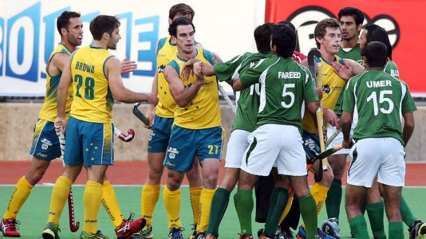 Australia's Kieran Govers, centre, and Pakistan's Fareed Ahmed get into a shoving match during the Kookaburras' 1-0 win ...