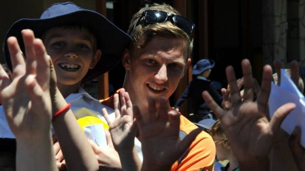 GWS Giants No.1 draft pick Lachie Whitfield entertains kids from Burgmann College.