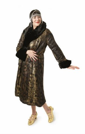 All that jazz … author and 1920s vintage-clothing collector Inger Sheil, wearing a 1920s gold lamé coat and headdress ...