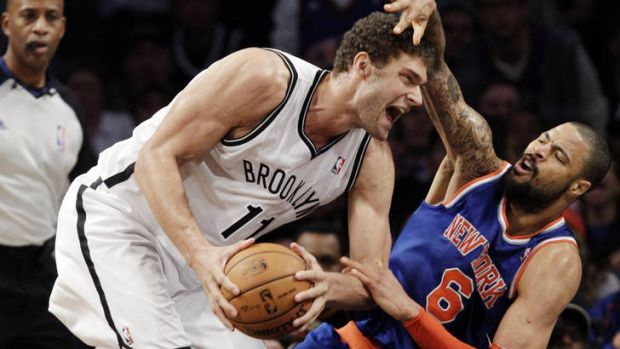 Brooklyn Nets centre Brook Lopez tangles with his New York Knicks counterpart Tyson Chandler in November. The rivalry ...
