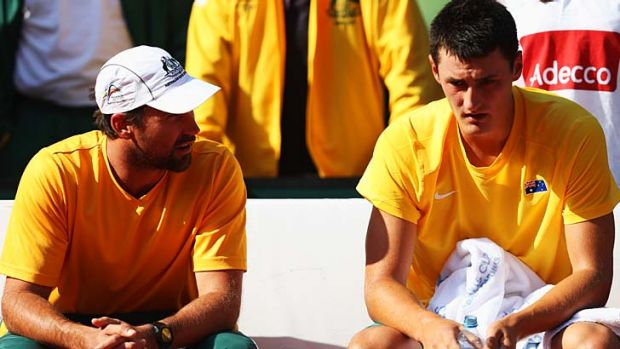 Tough love ... Pat Rafter has words with Bernard Tomic at the ill-fated Davis Cup world group play-off in September.
