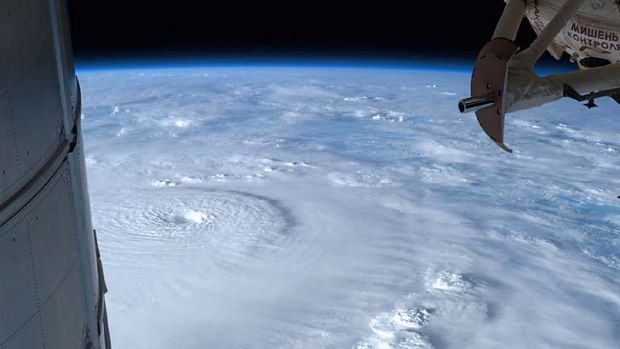 Growing swell ... a picture of typhoon Bopha as it bore down on the Philippines taken by Commander Kevin Ford on the ...