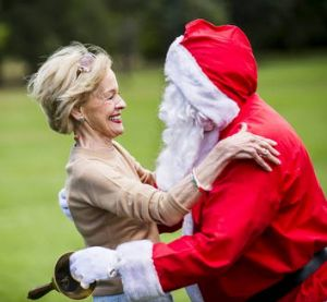 The Governor General Quentin Bryce gives Santa a welcome hug as he arrives at the Children?s Christmas Party at ...