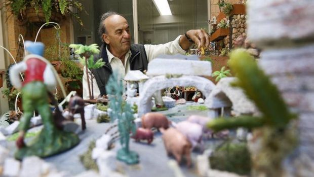 Ray Barbara at his Conder home makes adjustments to his Maltese Nativity Scene.
