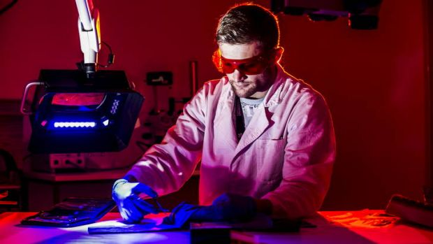 University of Canberra Honors student James Grech, works in the lab following the announcement of a partnership between ...