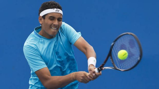 Nick Kyrgios plays a backhand in his 6-4, 6-3 victory over Harry Bourchier.