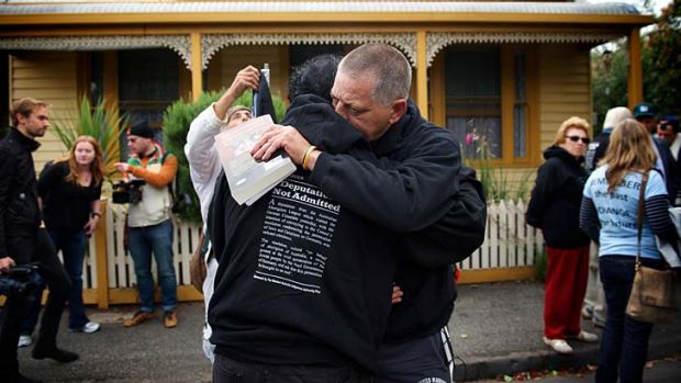 Kevin Russell hugs a fellow marcher as Jewish and Aboriginal supporters re-enact the 1938 protest march of his ...