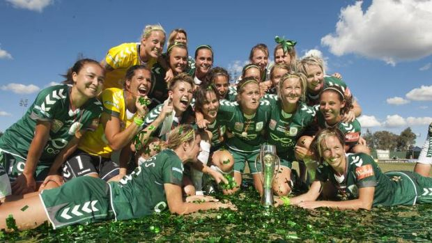 Canberra United players celebrate their W-League championship in January.