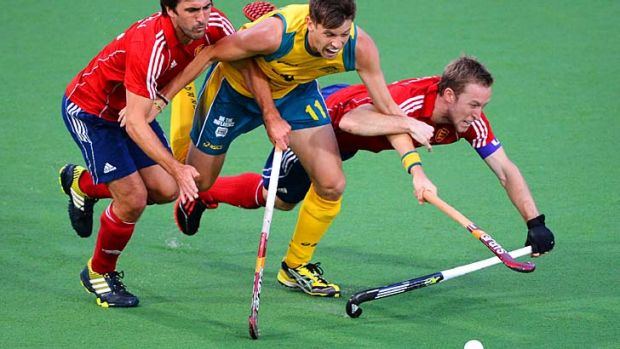 Middle man … Australia's Eddie Ockenden is tackled by England's Adam Dixon and Barry Middleton in the Champion's ...