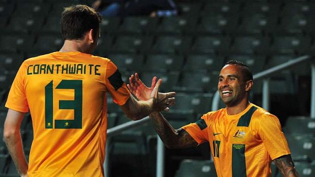 On target … Archie Thompson, right, celebrates.