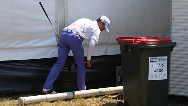 Wasted day … Chinese teenager Guan Tianlang retrieves his ball during a horror round on Thursday.