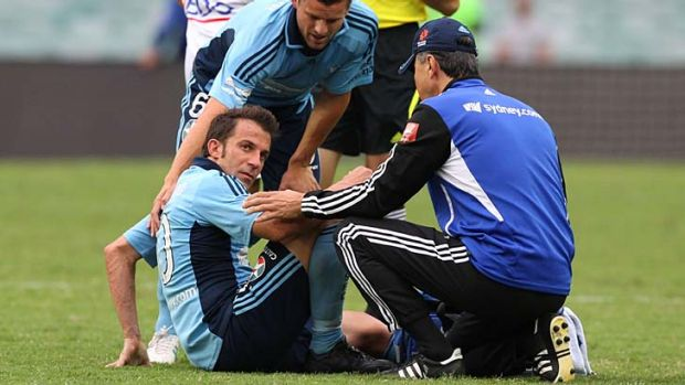 Down and out … Alessandro Del Piero feels the pain as a concerned Jason Culina looks on in Sydney's FC's scoreless ...