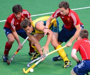 Caught: Australia's Jason Wilson is surrounded by England players on Thursday night.