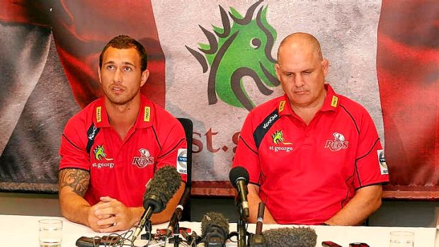 Quade Cooper and Queensland Reds coach Ewen McKenzie at Friday's announcement that the star five-eighth will remain in ...