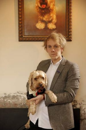 """Like having our own Suri Cruise"" ... Josh Thomas keeps his dog fashionably attired."