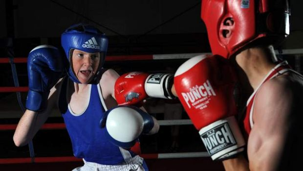 Young boxers Isaac Martin, left, and Adrian Farquhar sparring at the AIS.