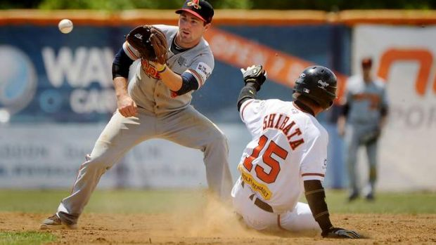 Canberra Cavalry's Kohei Shibata, right, slides safely into second base.