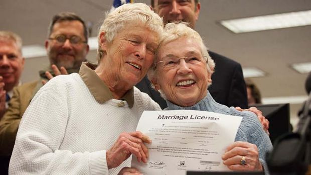Happy ... Jane Abbott Lighty and Pete-e Petersen were the first to get a licence after Washington state allowed gay marriage.