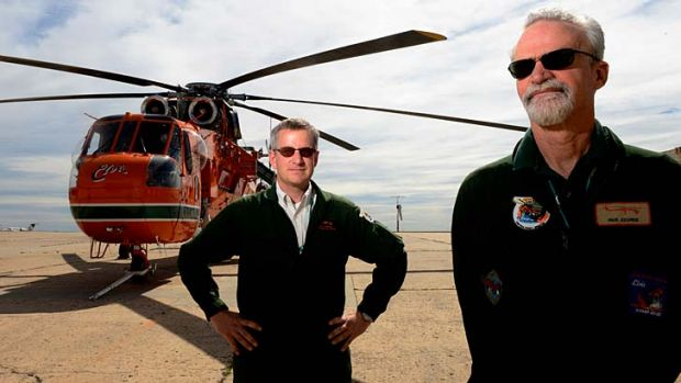 Pilots Andy Thomas (left) and Paul Kearns at Essendon airport for the arrival of the firefighting helicopter Elvis.