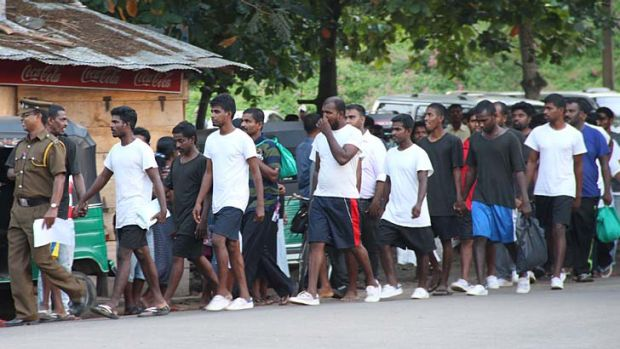 The latest batch of Sri Lankan deportees from Australia is led to court.