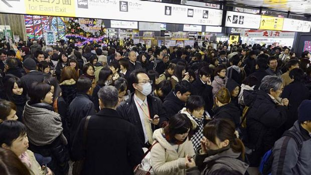 Passengers gather after train services were suspended following an earthquake at Sendai station in Sendai, Miyagi prefecture.