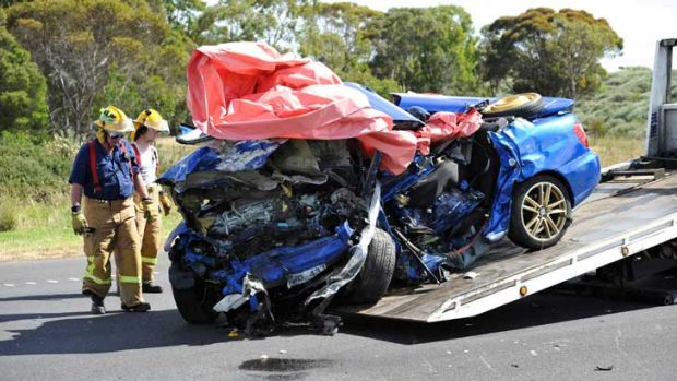 The wreckage of the vehicle containing six passengers.