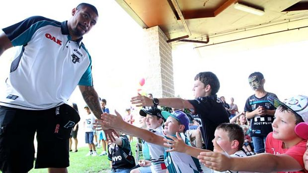 Reaching out to the community … star recruit Sika Manu meets some young Panthers supporters at the club's fan day ...