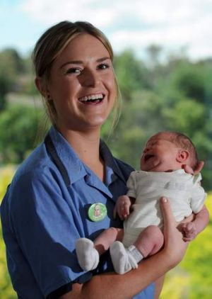 Graduate midwifery nurse, Rachael Williams, 21, of Queanbeyan, holds baby Baran (surname) at the Centenary Hospital for ...