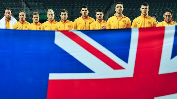 Vital … the Socceroos line up for the national anthem before Thursday's game against Guam. Australia hammered the ...