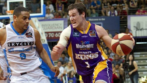 On top  ...  the Sydney Kings in action against the New Zealand Breakers on Saturday.