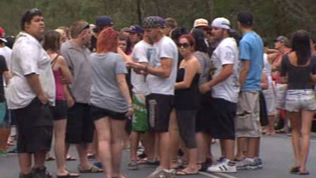 Friends of those killed in the crash at Coomera early Saturday gather where five died.