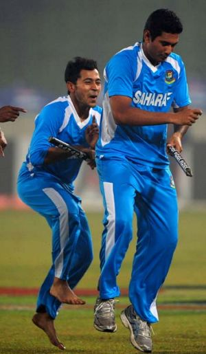 Bangladesh cricket captain Mushfiqur Rahim and Mohammad Mahmudullah do a jig after defeating the West Indies in the ...