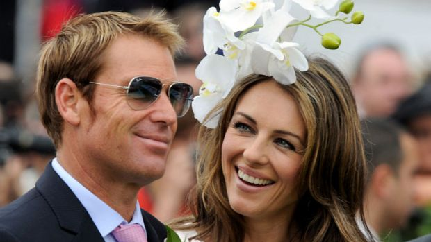Liz Hurley with Shane Warne at Crown Oaks Day at Flemington.
