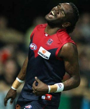 Liam Jurrah playing for the Demons.