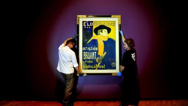 The poster boy of Paris ... One of the paintings from the Toulouse Lautrec exhibition being hung on Monday.