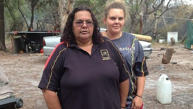 Carol Delaney (left) says she will rebuild her North Stradbroke Island home.