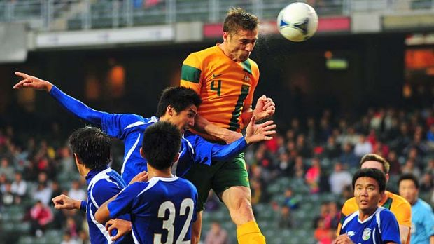 High point: Australia's Dino Djulbic wins the ball against Taiwan.
