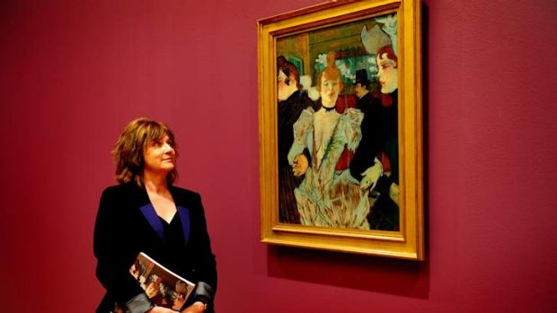 National Gallery senior curator Jane Kinsman looks at one of the paintings in the Toulouse Lautrec exhibition.