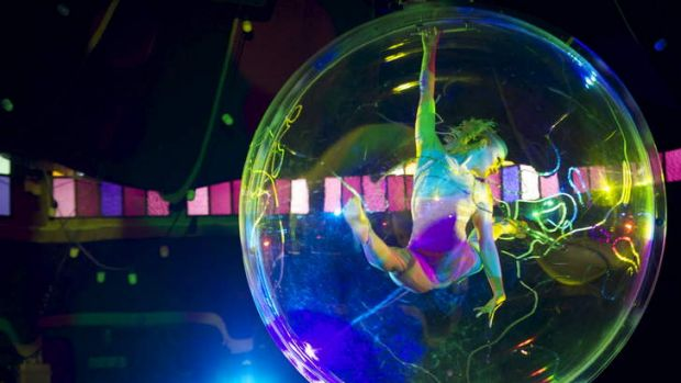 Contortionist Elena Lev performs inside a bubble in Spiegelworld's Empire.