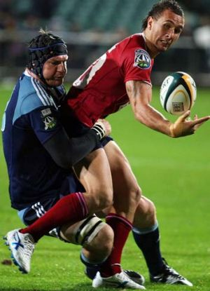 Ali Williams, seen here tackling Quade Cooper of the Reds, says he is honoured to be made captain of Auckland.