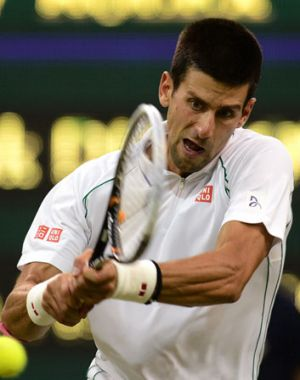 No, that's not a cheese ball he's hitting. Novak Djokovic hits a backhand on the court.