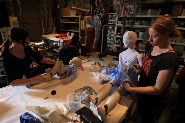 Puppeteers Katrina Lynch on left and Aesha Henderson on right working on puppets.