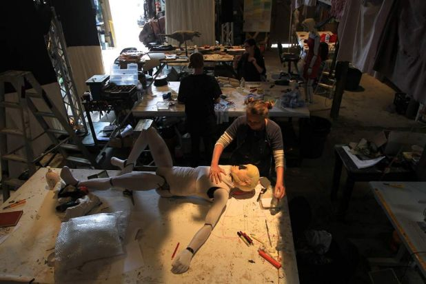 Erth puppeteer Kath Ellis working on a victim puppet in their workshop at Carriageworks for Erth's Sydney Festival Show ...