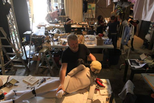 Scott Wright holding a victim puppet which is in the process of being made in the workshop at Carriageworks.