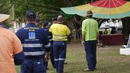 Brisbane City Council workers clean up the aboriginal tent embassy site at Musgrave Park