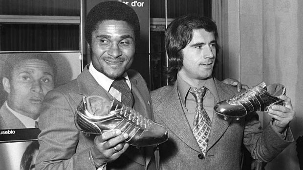 Gerd Müller (right) poses with Portugal's Eusebio during an awards ceremony in Paris in October 1973, after they ...