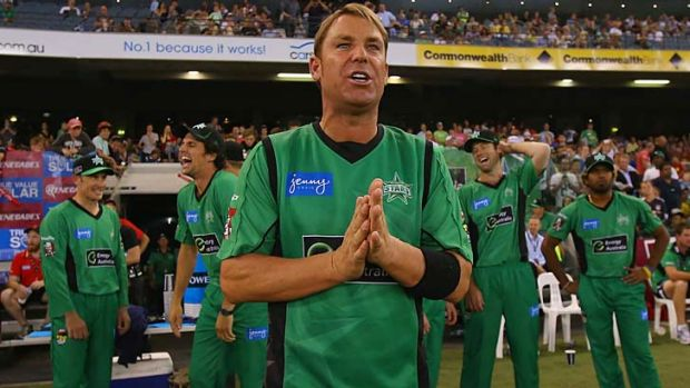Shane Warne gets ready to lead the Stars out for the game against the Renegades.
